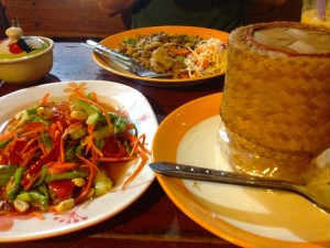 Som Tam on the left, Sticky Rice in the basket on the right, and Pad See Iew in the back.  All for $4.