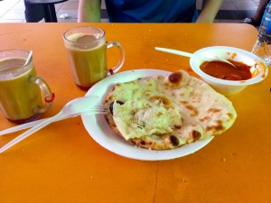 Left to right: Teh Tarik, Masala Tea, Garlic and Plain Naan, and Butter Chicken