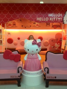 Here I am, striking a pose at the Hello Kitty Cafe.