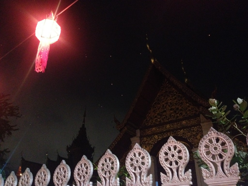 I'm so artsy. A lantern in front of a Wat (Buddhist Temple), with floating lanterns in the sky.