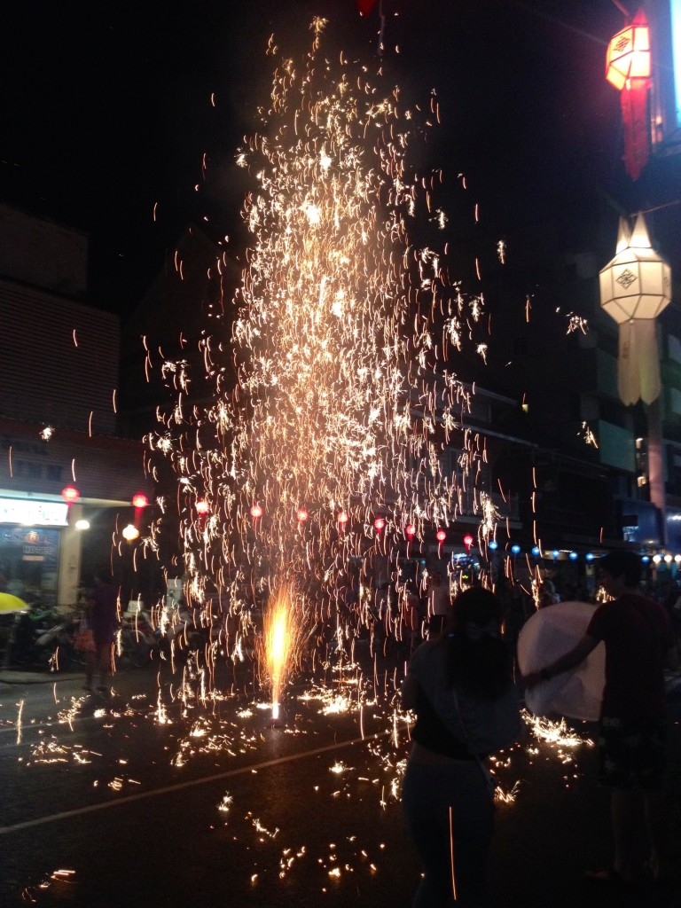 We were walking down a PACKED street after a parade, and people had to scramble when one hooligan set off this spark shower!