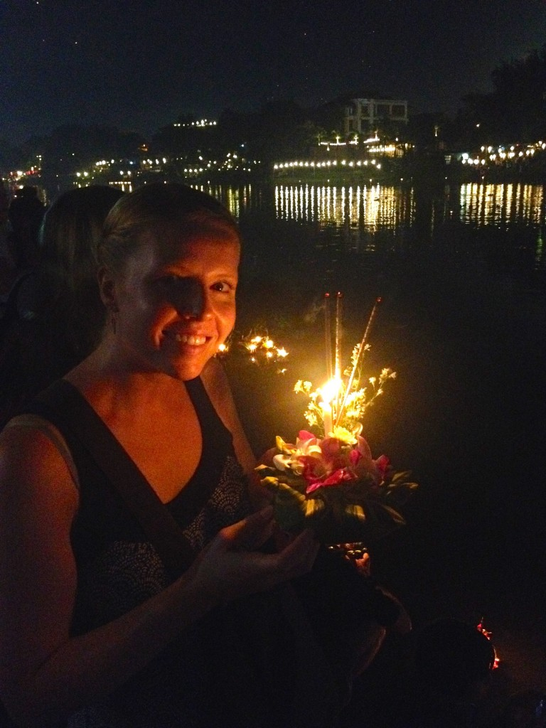 Celebrating Loy Krathong in Chiang May by releasing a Krathong into the Ping River