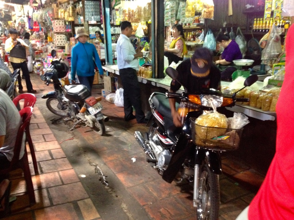 Oh You Know, Just Motorbikes Riding Through the Market...