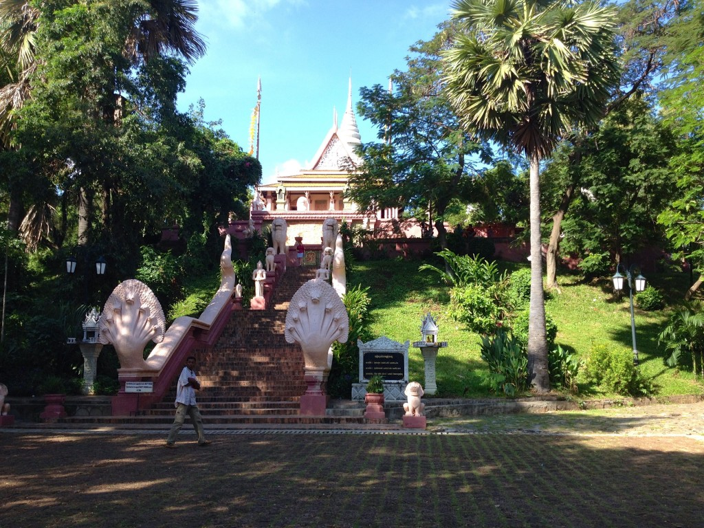 First Stop: Wat Phnom, a Buddhist Temple in the Center of Phnom Penh.