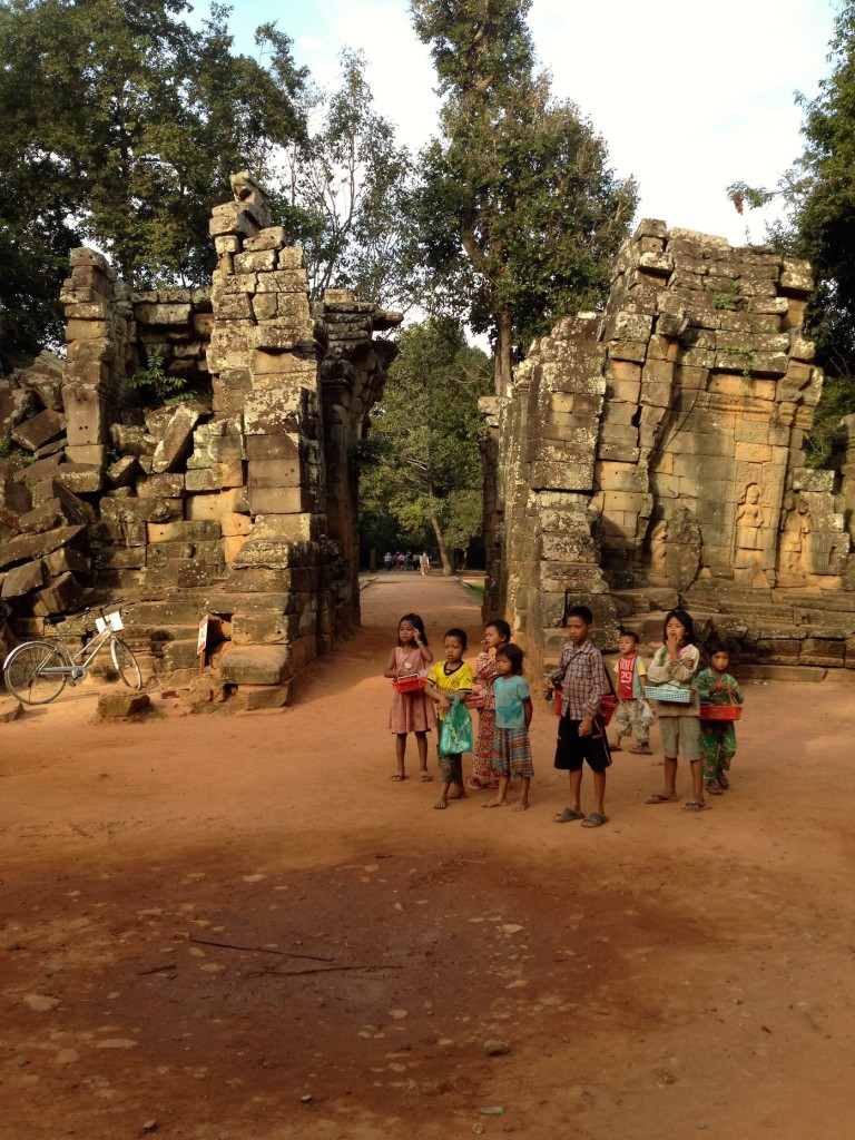 When we pulled up to Ta Prohm, the kids were out in full force to sell trinkets, souvenirs, and tour books.