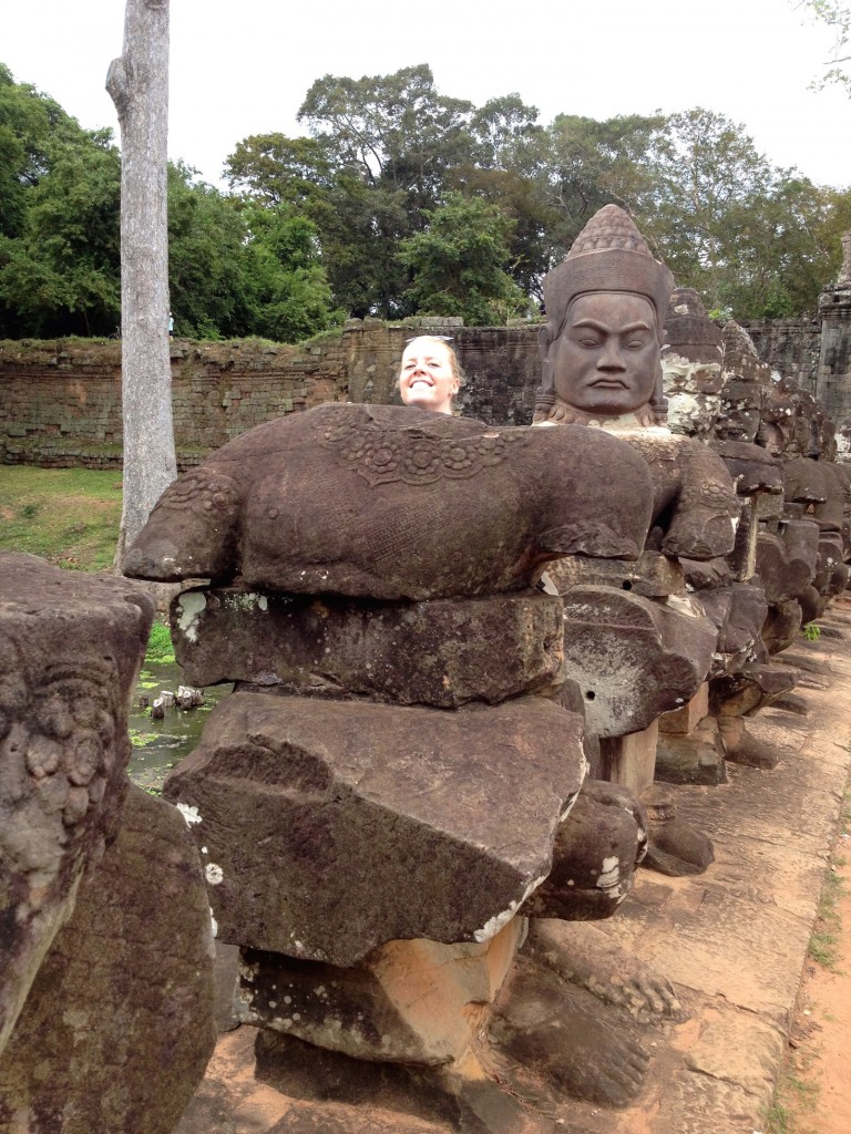 At the South Gate of Angkor Thom, some statues are missing their heads. Naturally, we made sure to replace it for our photo.