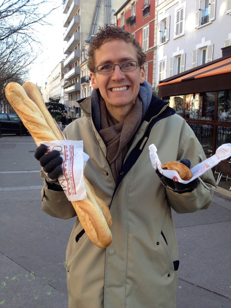 Here's Kevin with a baguette and a chocolate croissant. The bakery was just a 5-minute walk from the apartment, but we definitely ate the croissant before we got home...