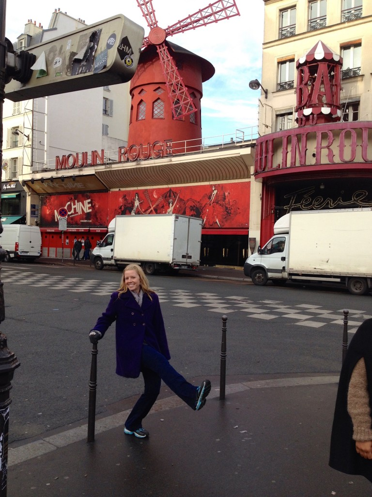 """After walking down Montmartre hill, we found ourselvesin a seedy neighborhood with lots of adult shops. I realized, """"Hey, we must be near the Moulin Rouge!"""" Sure enough, we were just 2 blocks away. Here I am, practicing my kicks for the burlesque show. Nailed it."""