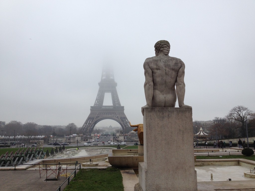 We accidentally saved our Eiffel Tower daytime visit for a day with a low cloud cover. Oops. As consolation, here's a nude statue with the Eiffel Tower.