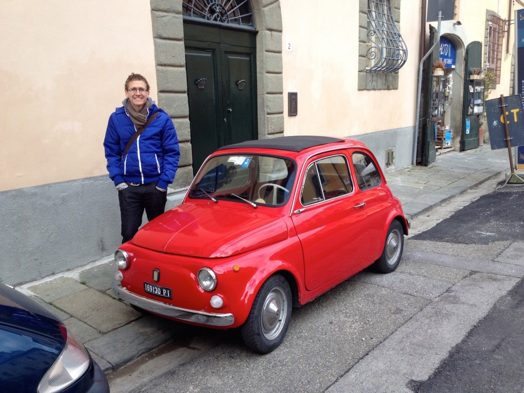 You may even find cute little red cars in Pisa that make you look like a GIANT!