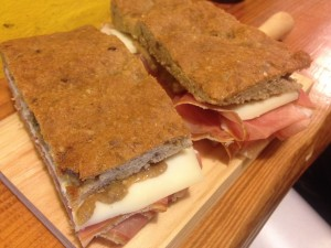 Prosciutto, Pecorino Romano and Cremini Mushroom Sauce on Multi-Grain Bread.