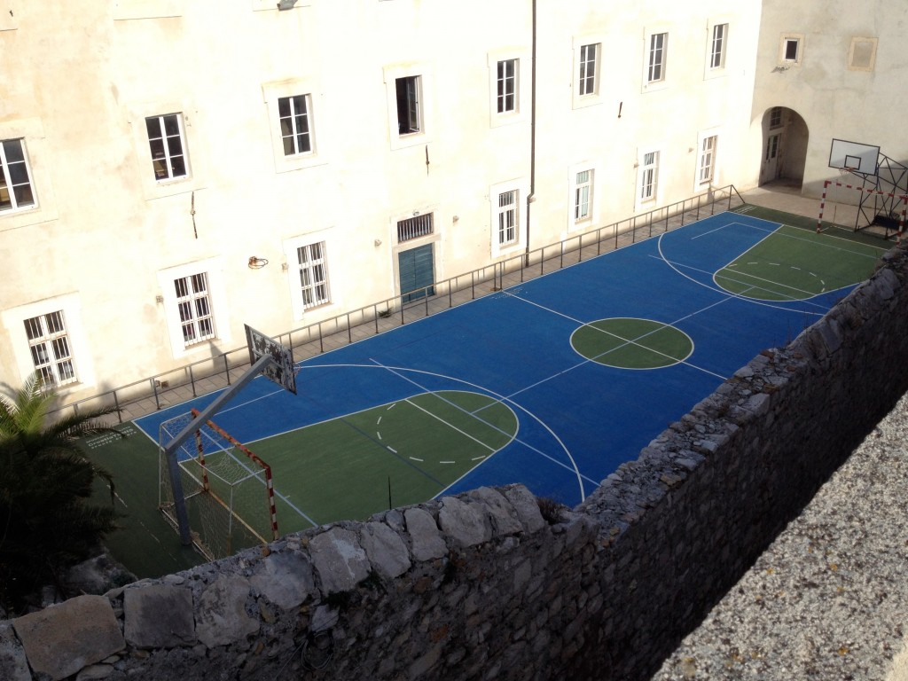 A rooftop soccer field / basketball court in the Old City.