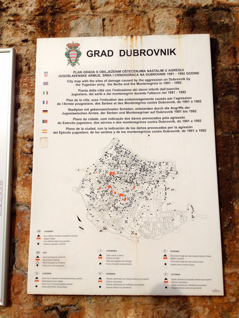 A map of Old Town Dubrovnik, showing damage from the 1991-1992 Siege. Orange marks buildings that burned down completely. Black triangles are direct hits on buildings, while black circles show direct hits on the pavement. Empty triangles and circles show shrapnel damage on buildigns and pavement, respectively.