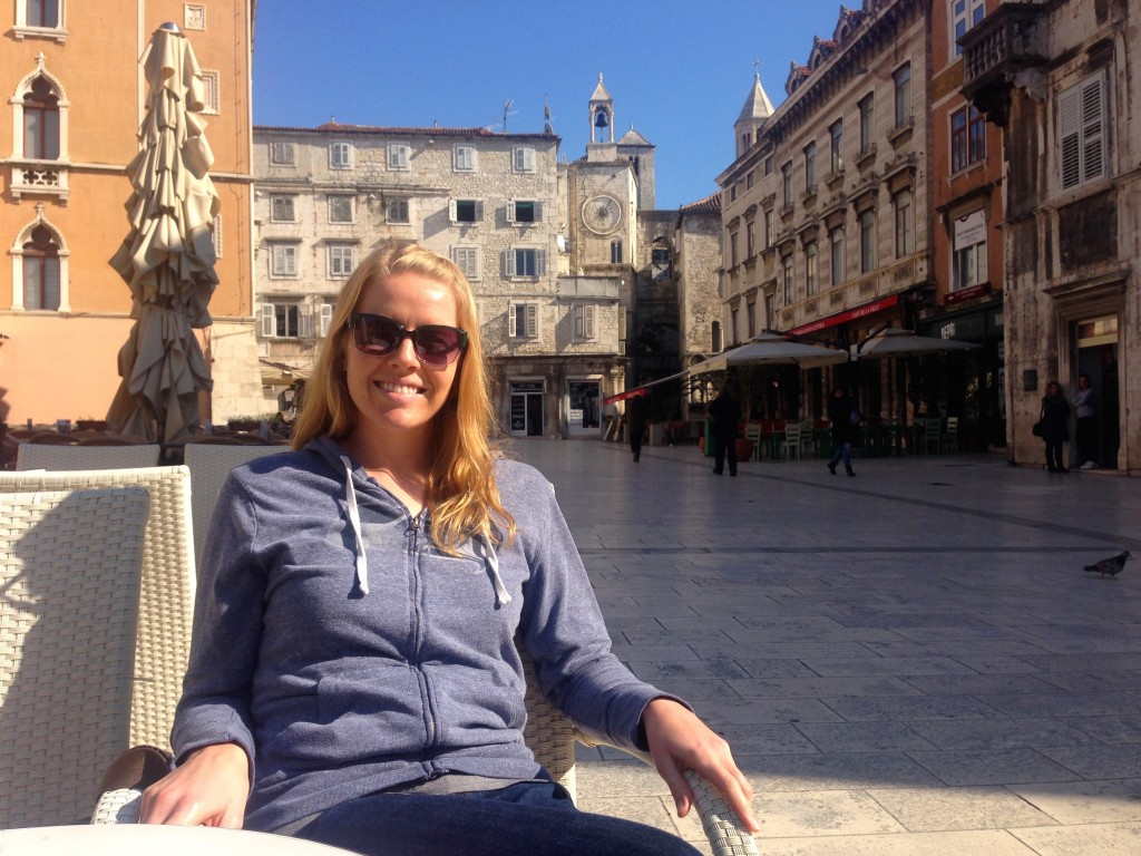 Soaking up some sunshine at Viva Cafe on People's Square. Split's clock tower is there over my left shoulder.