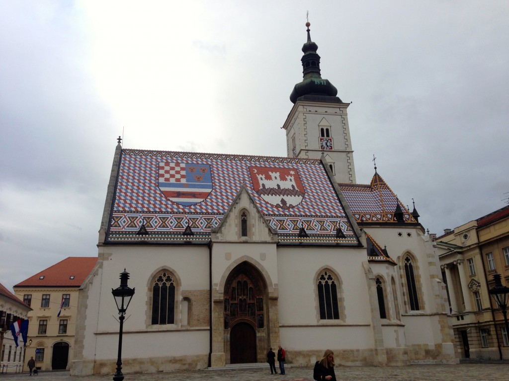 Zagreb's Church of St. Mark. What a cool roof, right? On the left is the North-Central Croatia coat of arms, and on the right is the Seal of Zagreb.