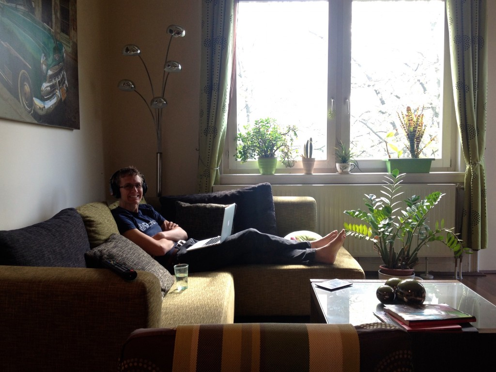 Here's Kevin in our sun-drenched living room working on the sofa.