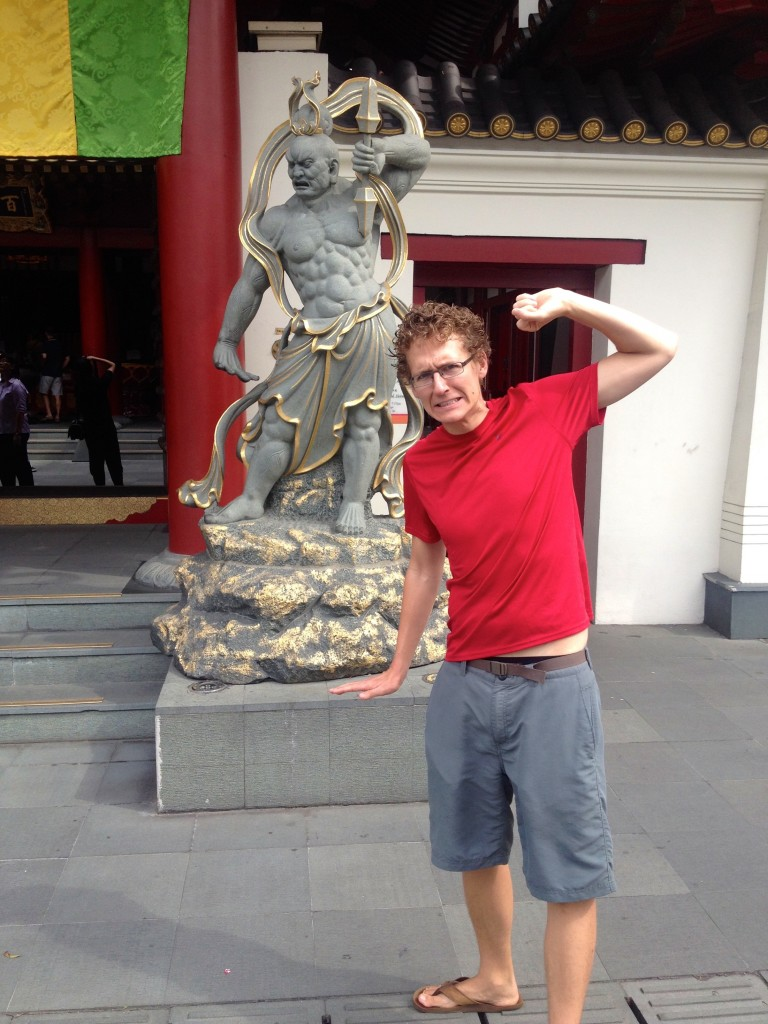 "This photo is called ""Kevin, Singaporean Warrior"". Taken outside a temple in Singapore."