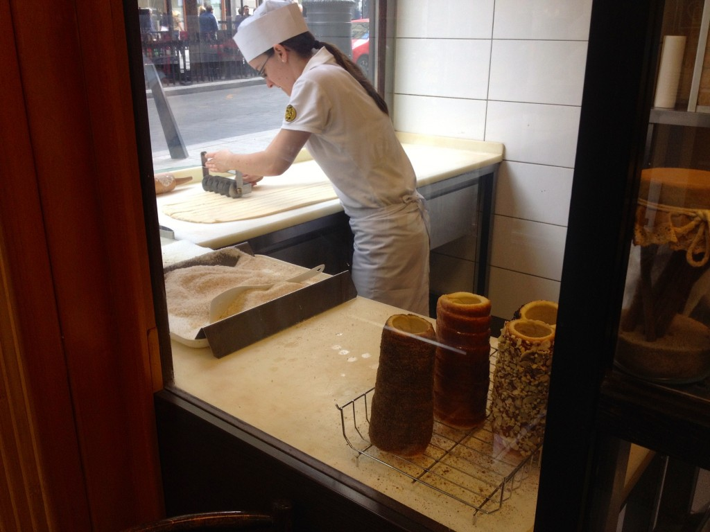 One of the bakers, working hard on making those Chimney Cakes.