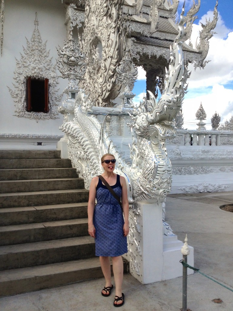 We're getting good at the dragon pose. This was in Chiang Rai, Thailand at the White Temple.