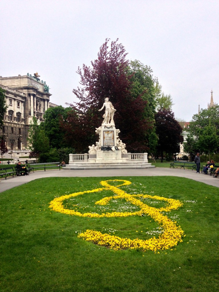 Check out this awesome treble clef made in the grass with yellow flowers!! That's a statue of Mozart in the background.