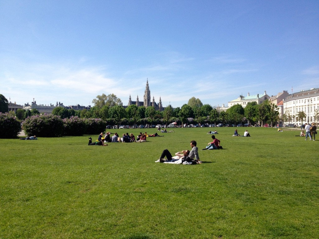 Locals out enjoying the sunshine in Heldenplatz Square.