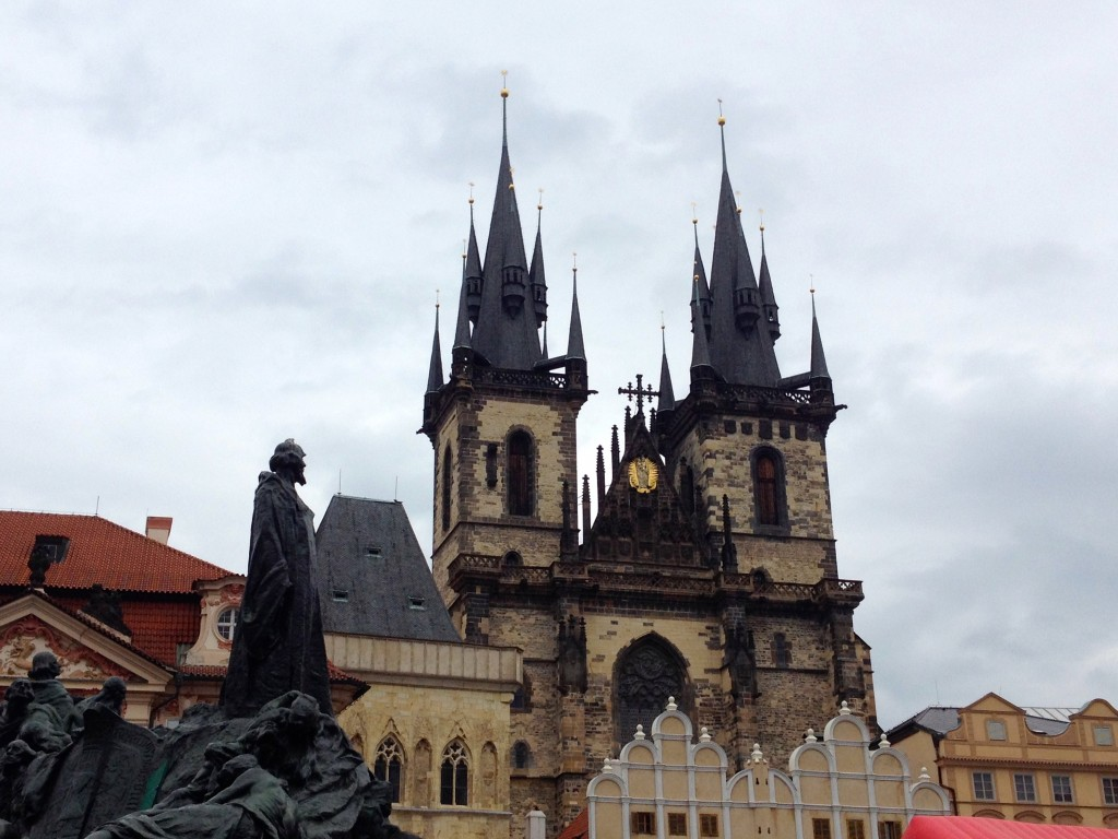 This is the Tyn Church on Old Town Square, and the statue in the foreground is the Jan Hus Memorial. Jan Hus was executed for speaking out against church corruption in the 1400s.